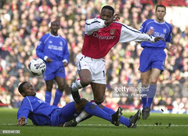 LEAGUE Arsenal's Lauren is stopped in his tracks by Chelsea's Celestine Babayaro during the FA Cup Fifth Round football match at Highbury London