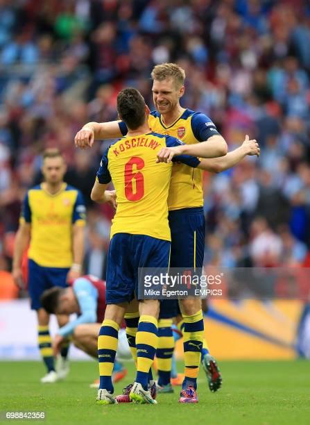 Arsenal's Laurent Koscielny and Arsenal's Per Mertesacker celebrate victory