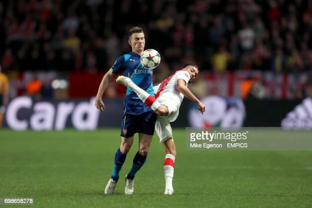 Arsenal's Laurent Koscielny and AS Monaco's Nabil Dirar battle for the ball
