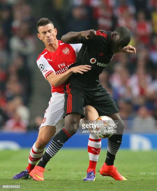 Arsenal's Laurent Koscielny and Besiktas' Demba Ba battle for the ball