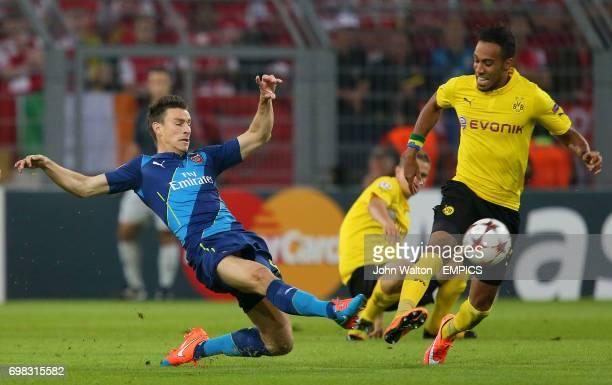Arsenal's Laurent Koscielny and Borussia Dortmund's PierreEmerick Aubameyang battle for the ball
