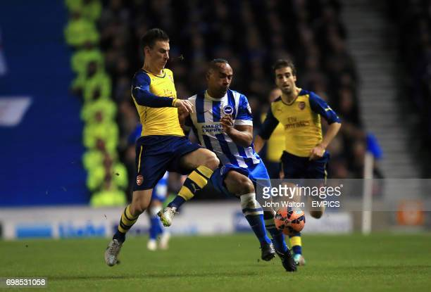 Arsenal's Laurent Koscielny and Brighton and Hove Albion's Chris O'Grady battle for the ball