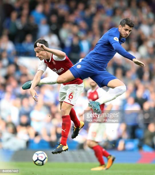 Arsenal's Laurent Koscielny and Chelsea's Alvaro Morata battle for the ball during the Premier League match at Stamford Bridge London