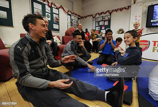 Arsenal's Laurent Koscielny and Francis Coquelin during a visit to charity Centre 404 on December 22 2016 in London England