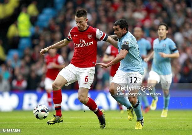 Arsenal's Laurent Koscielny and Manchester City's Carlos Tevez battle for the ball during the Barclays Premier League match at the Etihad Stadium...
