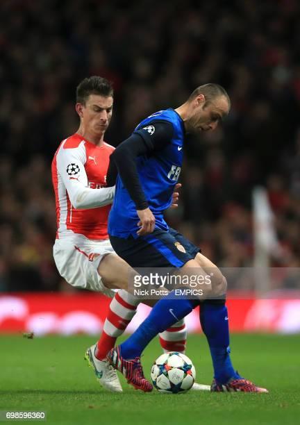 Arsenal's Laurent Koscielny and Monaco's Dimitar Berbatov battle for the ball