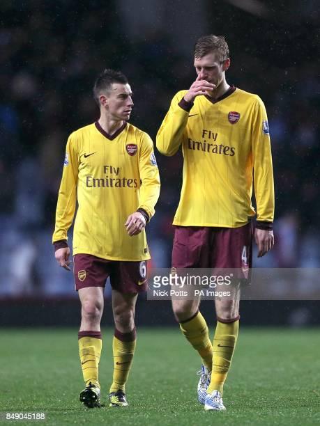 Arsenal's Laurent Koscielny and Per Mertesacker walk off together after the final whistle