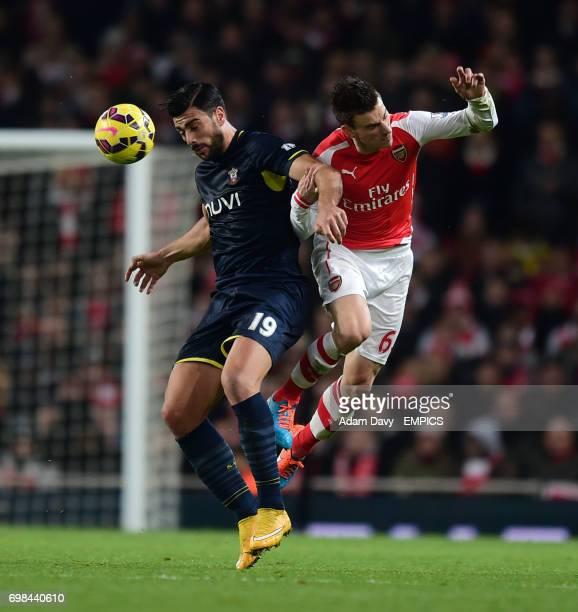 Arsenal's Laurent Koscielny and Southampton's Graziano Pele