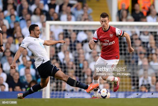 Arsenal's Laurent Koscielny and Tottenham Hotspur's Nacer Chadli battle for the ball