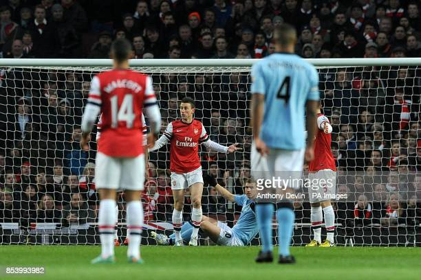 Arsenal's Laurent Koscielny appleals after a collision with Manchester City's Edin Dzeko