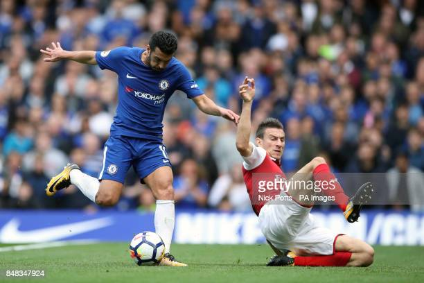 Arsenal's Laurent Koscielny attempts to block a shot from Chelsea's Pedro during the Premier League match at Stamford Bridge London