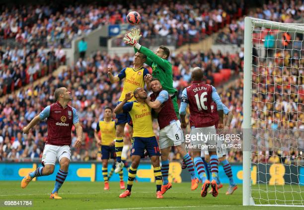 Arsenal's Laurent Koscielny battles for the ball with Aston Villa's goalkeeper Shay Given