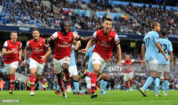Arsenal's Laurent Koscielny celebrates scoring during the Barclays Premier League match at the Etihad Stadium Manchester