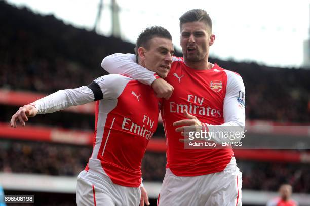 Arsenal's Laurent Koscielny celebrates scoring his sides first goal of the game with team mate Olivier Giroud