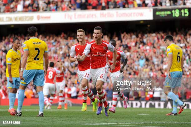 Arsenal's Laurent Koscielny celebrates scoring their first goal of the game during the Barclays Premier League match at The Emirates Stadium London