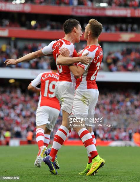 Arsenal's Laurent Koscielny celebrates scoring their first goal of the game with teammate Calum Chambers during the Barclays Premier League match at...