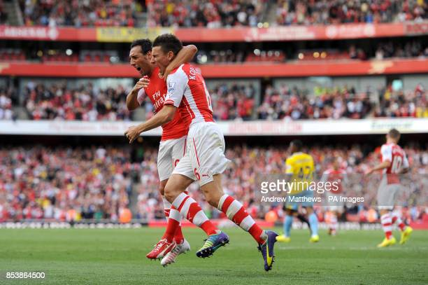 Arsenal's Laurent Koscielny celebrates scoring their first goal of the game with teammate Santi Cazorla during the Barclays Premier League match at...