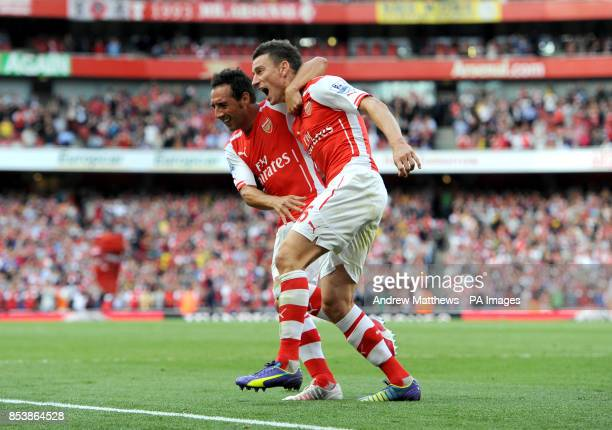 CROP* Arsenal's Laurent Koscielny celebrates scoring their first goal of the game with teammate Santi Cazorla during the Barclays Premier League...