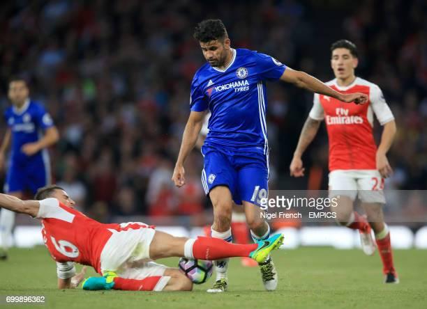 Arsenal's Laurent Koscielny challenges Chelsea's Diego Costa
