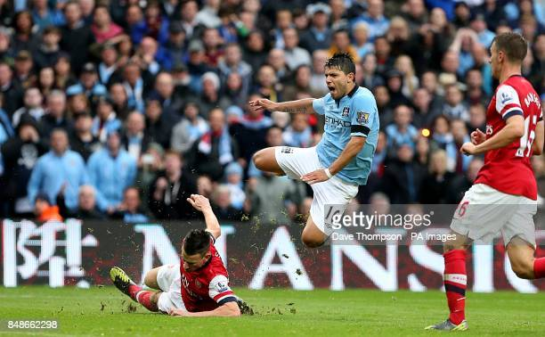 Arsenal's Laurent Koscielny challenges Manchester City's Sergio Aguero for the ball