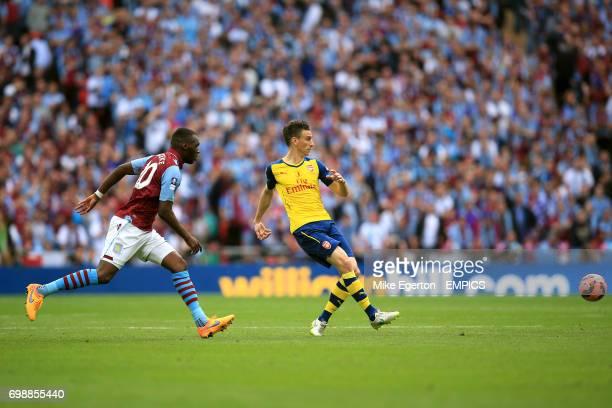 Arsenal's Laurent Koscielny clears the danger from Aston Villa's Christian Benteke