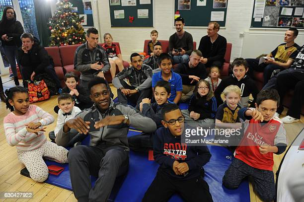 Arsenal's Laurent Koscielny Danny Welbeck Theo Walcott and Francis Coquelin during a visit to charity Centre 404 on December 22 2016 in London England