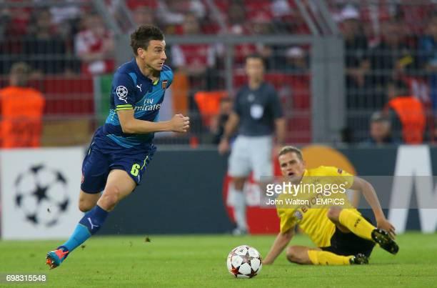 Arsenal's Laurent Koscielny gets away from Borussia Dortmund's Sven Bender