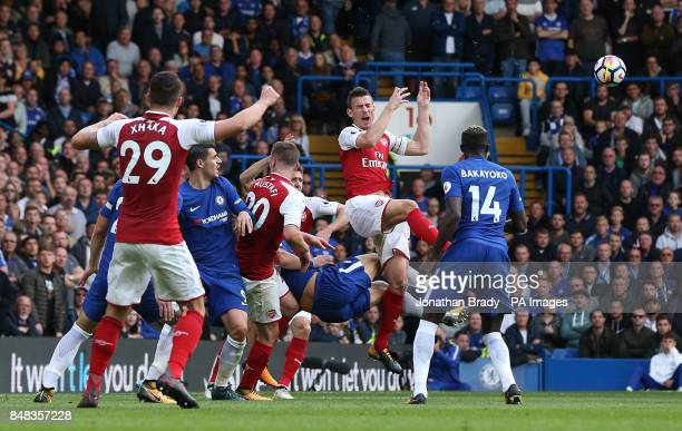 Arsenal's Laurent Koscielny is caught in the head by a high boot from Chelsea's David Luiz during the Premier League match at Stamford Bridge London