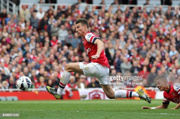 Arsenal's Laurent Koscielny is unable to stop a freekick from Chelsea's Juan Mata finding the back of the net