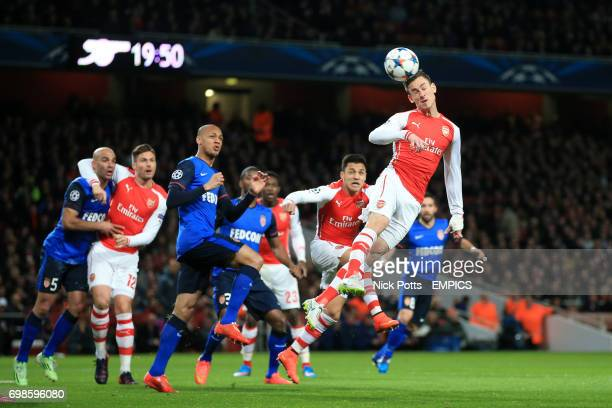 Arsenal's Laurent Koscielny rises highest in a crowded penalty area to get a headed effort on goal
