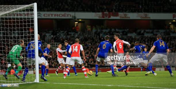 Arsenal's Laurent Koscielny scores his sides first goal of the game against Leicester City