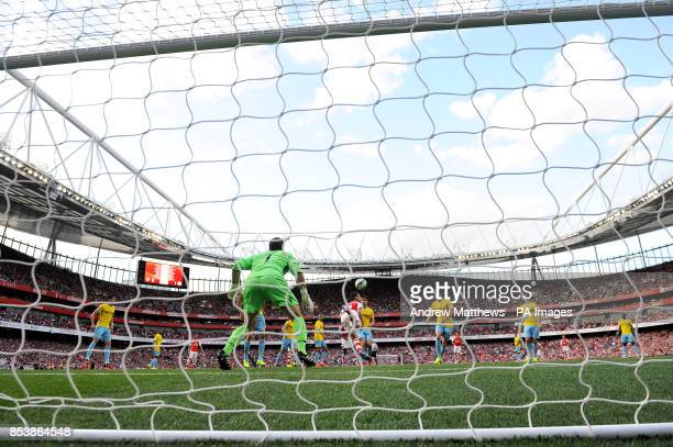 Arsenal's Laurent Koscielny scores their first goal of the game during the Barclays Premier League match at The Emirates Stadium London