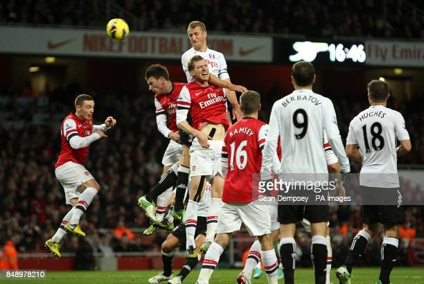 Arsenal's Laurent Koscielny takes a header on target