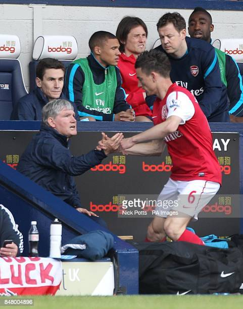 Arsenal's Laurent Koscielny with assistant manager Pat Rice
