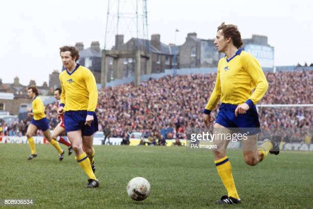 Arsenal's Liam Brady and Sammy Nelson run for the ball