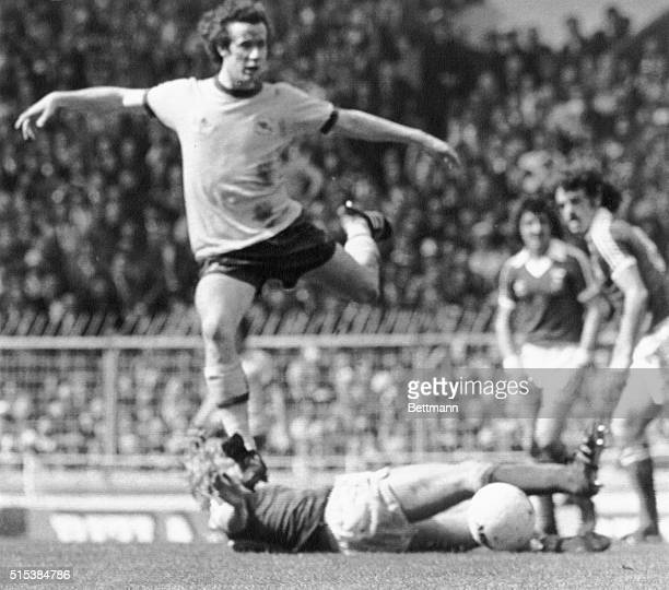Arsenal's Liam Brady flies over Ipswich Town's David Geddis after ball during play here Arsenal was leading 10
