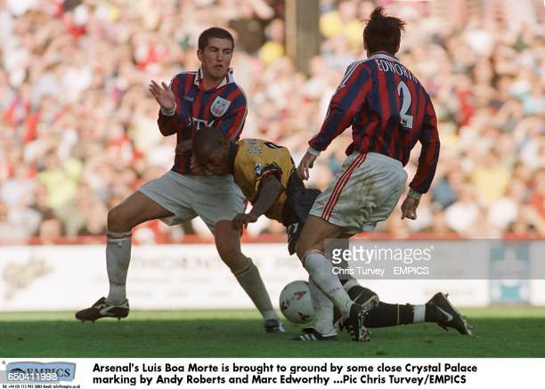 Arsenal's Luis Boa Morte is brought to ground by the close marking of Crystal Palace's Andy Roberts and Marc Edworthy