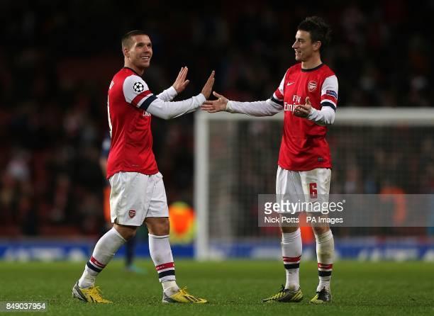 Arsenal's Lukas Podolski and Laurent Koscielny after the game