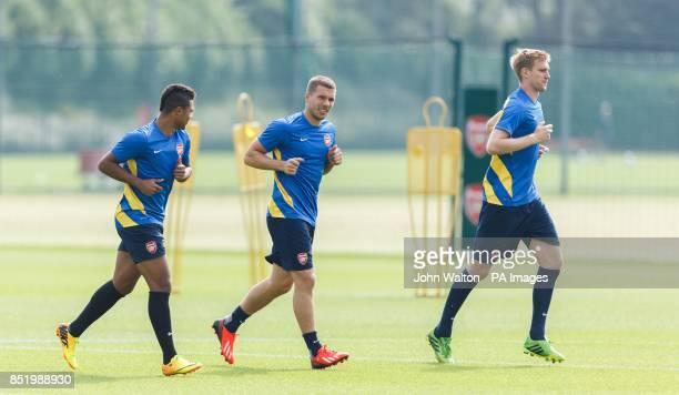 Arsenal's Lukas Podolski and Per Mertesacker during a training session at London Colney St Albans