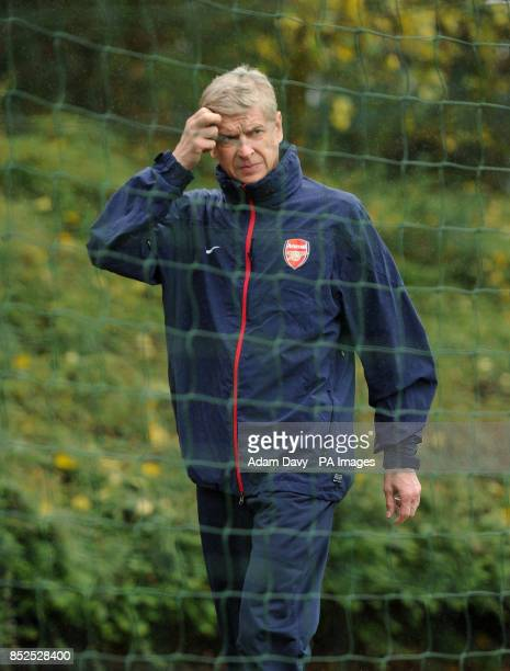 Arsenal's Manager Arsene Wenger makes his way to training during a training session at London Colney St Albans
