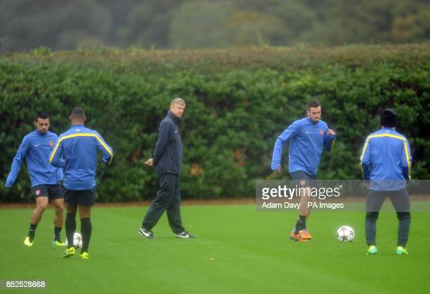 Arsenal's Manager Arsene Wenger watches his players during a training session at London Colney St Albans