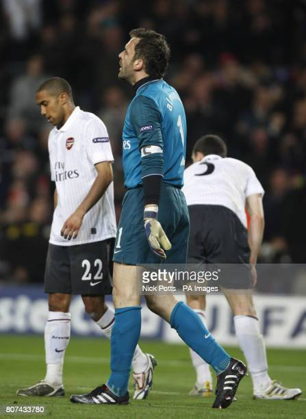 Arsenal's Manuel Almunia Gael Clichy and Thomas Vermaelen show their dejection after Barcelona's Lionel Messi scores his fourth goal of the game...
