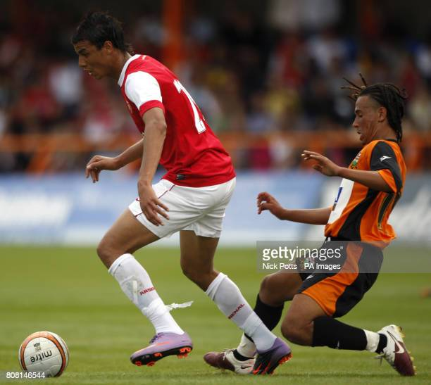Arsenal's Marouane Chamakh and Barnet's Sam Cox battle for the ball