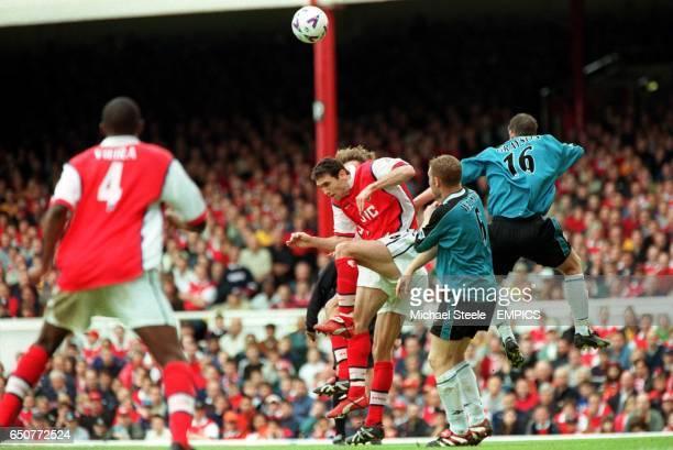 Arsenal's Martin Keown jumps with Aston Villa's Steve Watson and Simon Grayson