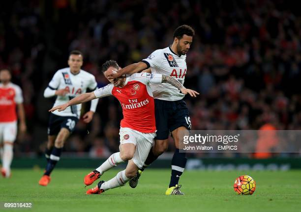 Arsenal's Mathieu Debuchy battles for the ball with Tottenham Hotspur's Mousa Dembele