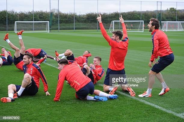 Arsenal's Mathieu Debuchy Hector Bellerin Olivier Giroud and Mathieu Flamini before a training session at London Colney on October 30 2015 in St...