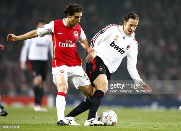 Arsenal's Mathieu Flamini and AC Milan's Massimo Ambrosini battle for the ball