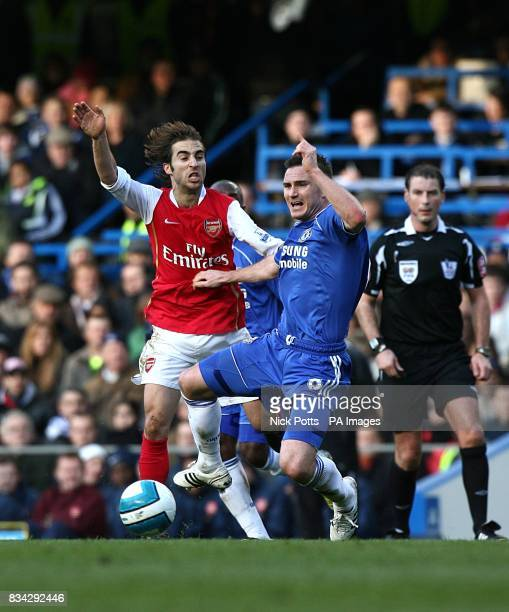 Arsenal's Mathieu Flamini and Chelsea's Frank Lampard battle for the ball