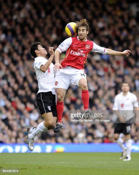 Arsenal's Mathieu Flamini and Fulham's Seol KiHyeon battle for the ball