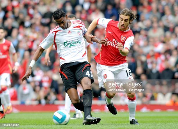 Arsenal's Mathieu Flamini and Liverpool's Damien Plessis battle for the ball